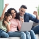 Excited family with laptop