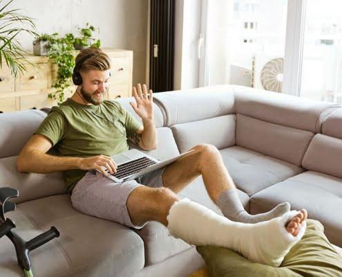 man in leg cast